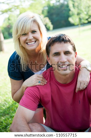 Happy married couple outside - stock photo