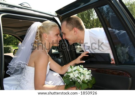 Happy married. Newlywedses beside machines. This photo is not correction. - stock photo
