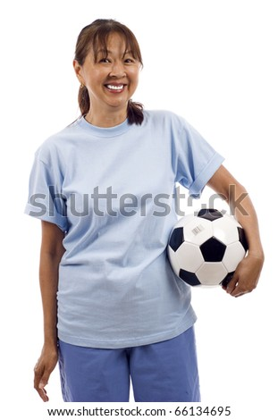 Happy mature Asian woman holding a soccer ball football isolated over white background - stock photo