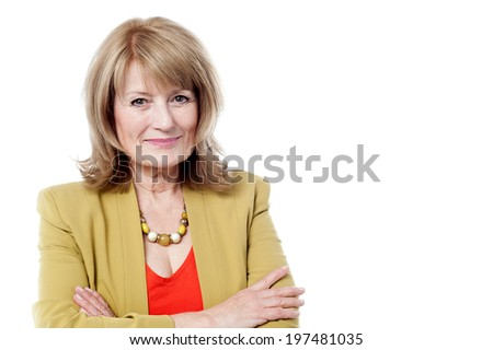 Happy mature business woman arms folded