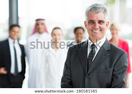 happy mature businessman looking at the camera - stock photo