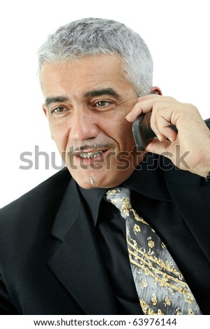 Happy mature businessman talking on mobile phone, smiling, isolated on white background.? - stock photo