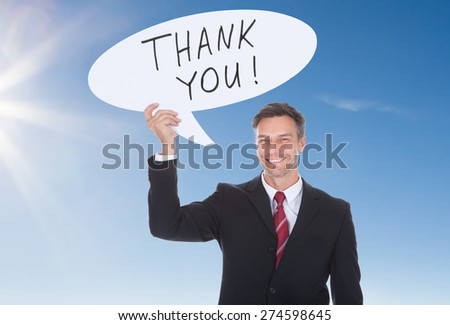 Happy Mature Businesswoman Holding Speech Bubble With Thank You Text - stock photo