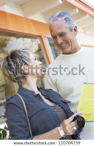 Happy mature Caucasian couple on vacation - stock photo