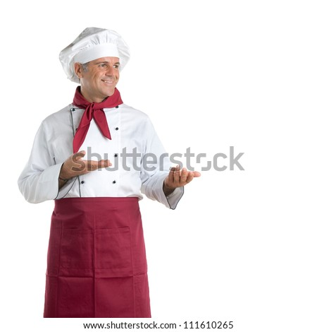 Happy mature chef showing your text or product isolated on white background