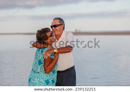 Happy Mature Couple at the Beach - stock photo