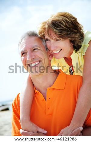Happy mature couple embracing. - stock photo