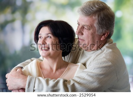 Happy mature couple embracing, outdoor