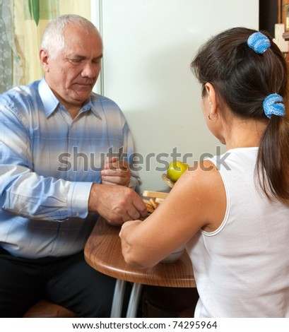Happy mature couple having morning coffee indoor