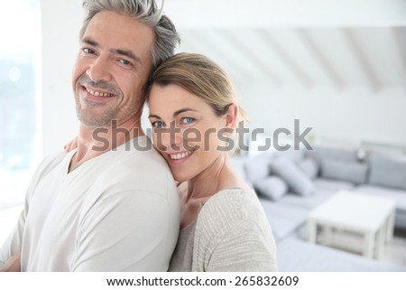 Happy mature couple in brand new home - stock photo