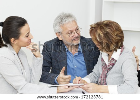 Happy mature Couple in Meeting With Advisor. - stock photo