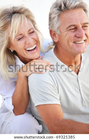 Happy mature couple laughing.