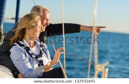 Happy Mature Couple Looking At View - stock photo