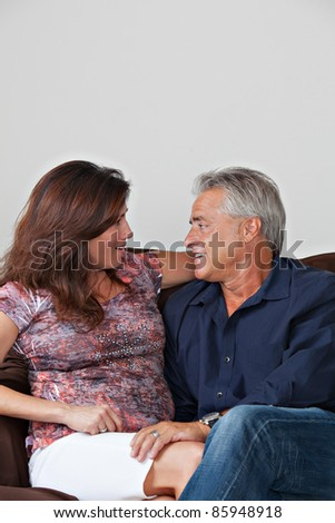 Happy mature couple posing for portrait - stock photo