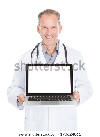 Happy Mature Doctor Showing Laptop Over White Background