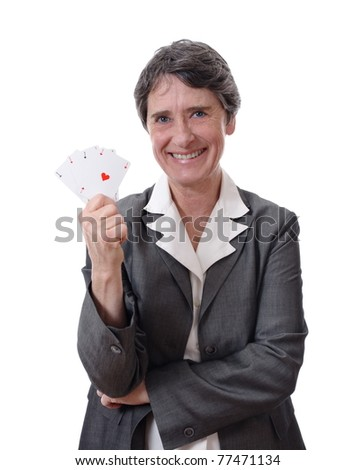 happy mature lady showing four aces isolated on white background