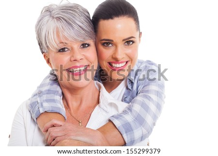 happy mature mother and adult daughter hugging on white background - stock photo