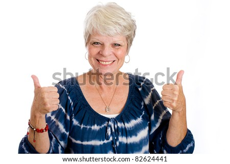 Happy, mature, white haired woman with two thumbs up. - stock photo