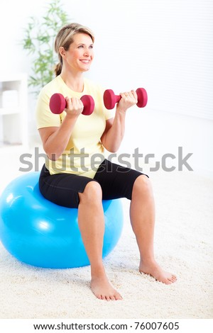 Happy mature woman doing fitness. Healthy life. - stock photo