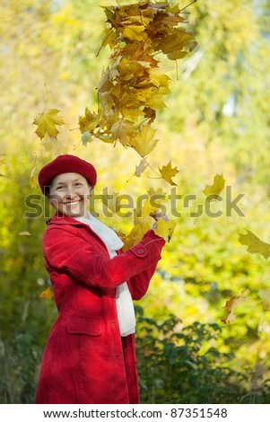 happy mature woman  in autumn park