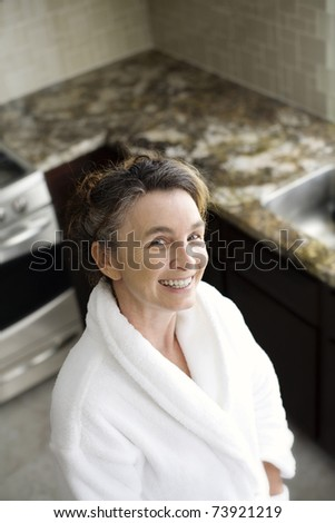 happy mature woman in the kitchen
