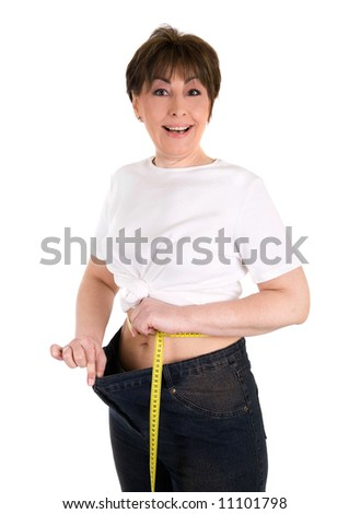 happy mature woman on a diet losing weight - stock photo