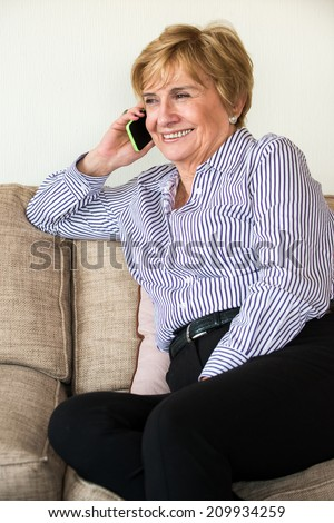 Happy Mature woman speaking on the phone - stock photo