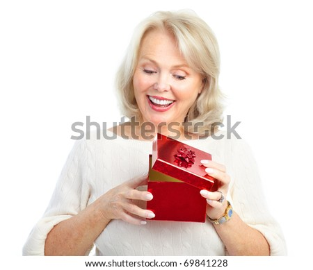 Happy  mature woman with a gift. Isolated over white background - stock photo
