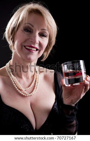 Happy Mature Woman With Drink - stock photo