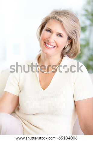 Happy mature woman with great smile - stock photo