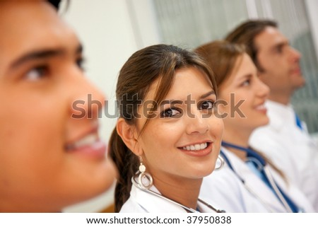 happy medical team in a hospital smiling