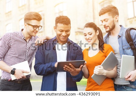Happy men and woman are using modern technology - stock photo