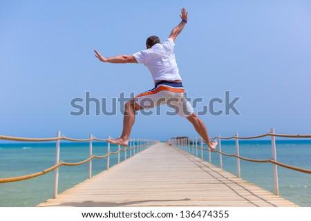 Happy men over red sea in Egypt - stock photo
