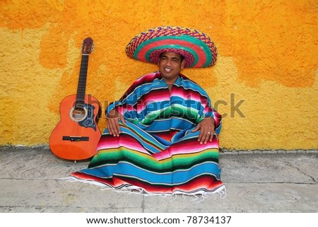Happy mexican sit man typical sombrero hat colorful serape guitar - stock photo