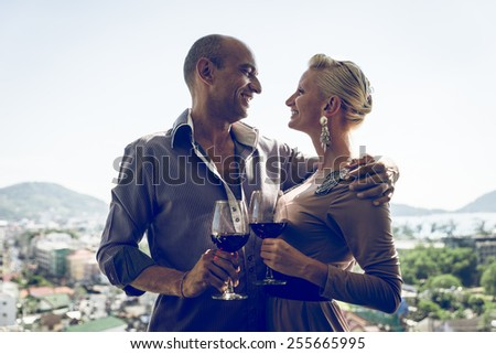 happy middle age couple having dinner in a restaurant and enjoying the view on the city - stock photo