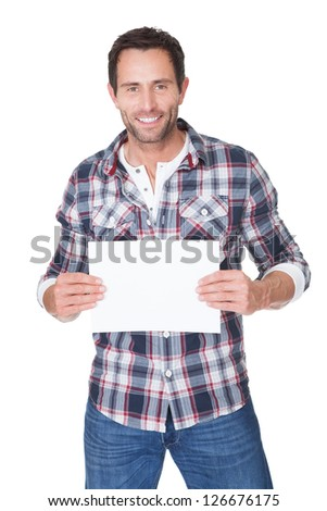 Happy middle age man presenting empty paper. Isolated on white - stock photo