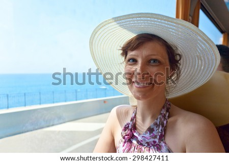 Happy middle age woman traveling in the bus - stock photo