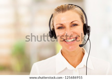 happy middle aged businesswoman with headphones - stock photo