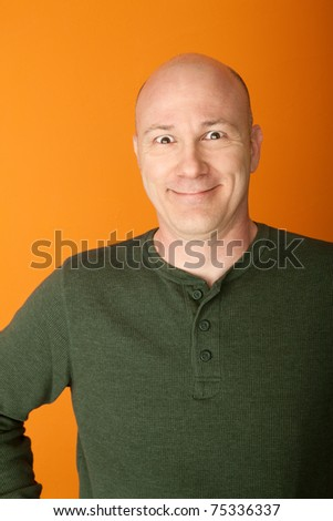 Happy middle-aged Caucasian man on orange background - stock photo