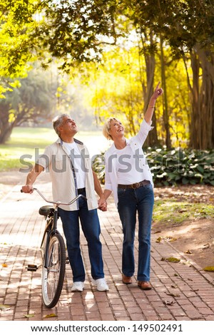 happy middle aged couple enjoying being outdoors - stock photo
