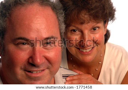 happy middle aged couple focus on the woman