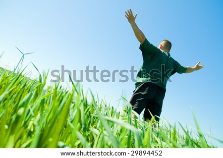 Happy middle-aged man on the summer field - stock photo