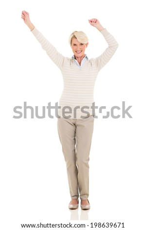 happy middle aged woman dancing on white background - stock photo