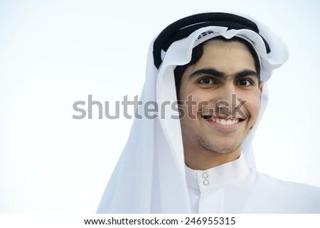 Happy Middle eastern Gulf teenage boy - stock photo