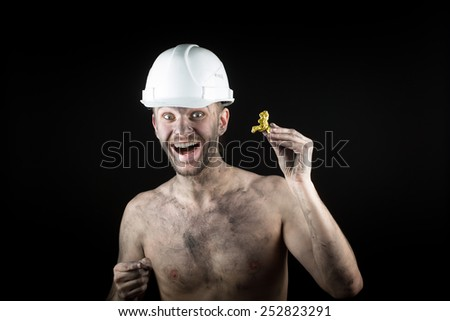 happy  miner shows a golden nugget