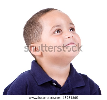 Happy mixed race boy looking up on white background