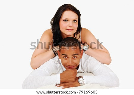Happy mixed race couple togetherness pose - stock photo
