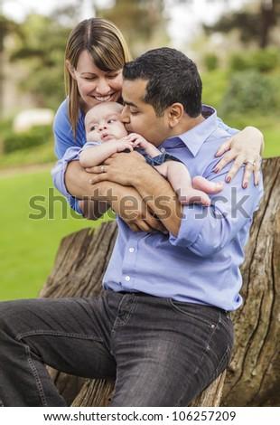 Happy Mixed Race Family Enjoying The Park Together. - stock photo