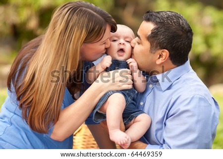 Happy Mixed Race Parents Playing with Their Giggling Son. - stock photo
