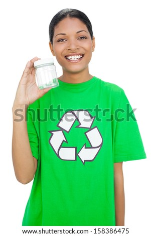 Happy model wearing recycling tshirt holding pot on white background - stock photo